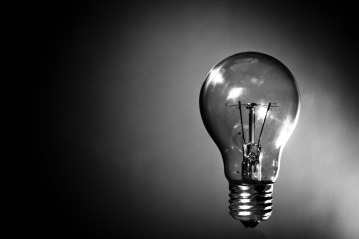 an artsy black-and-white picture of a lightbulb